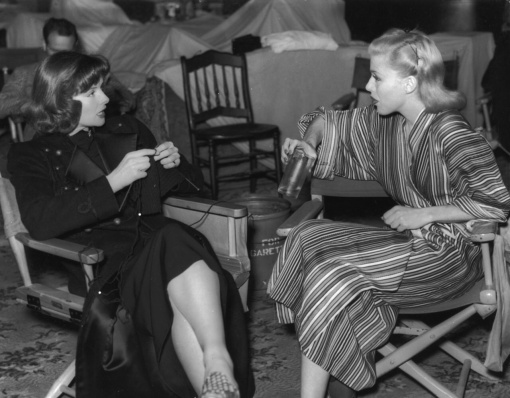 Katharine Hepburn does a little knitting  on the set of STAGE DOOR with Ginger Rogers