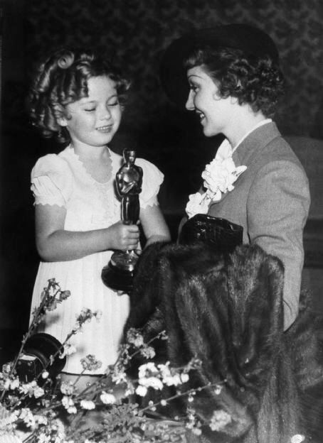 Presenting Claudette Colbert  with her Oscar for It Happened One Night