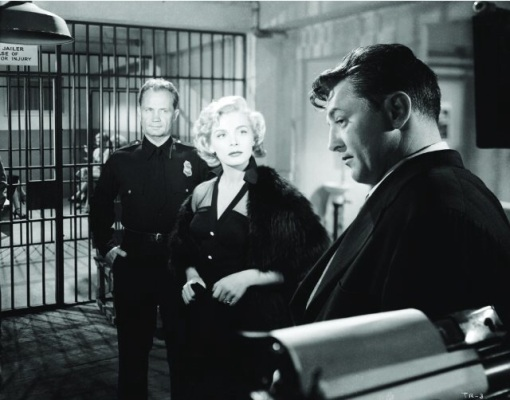 With Robert Mitchum. THE RACKET