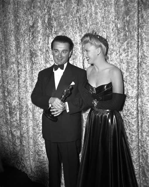 Miklos Rozsa. Best score for SPELLBOUND. Presenter Ginger Rogers