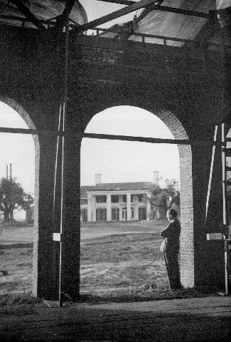 David o.Selznick standing in the GWTW set of the train depot,looking up to TARA