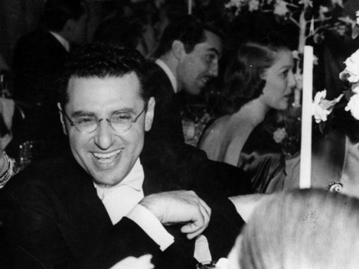 George Cukor. (Cesar Romero,Loretta Young in background.)